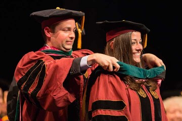 College of Medicine hoods 1,000th graduate